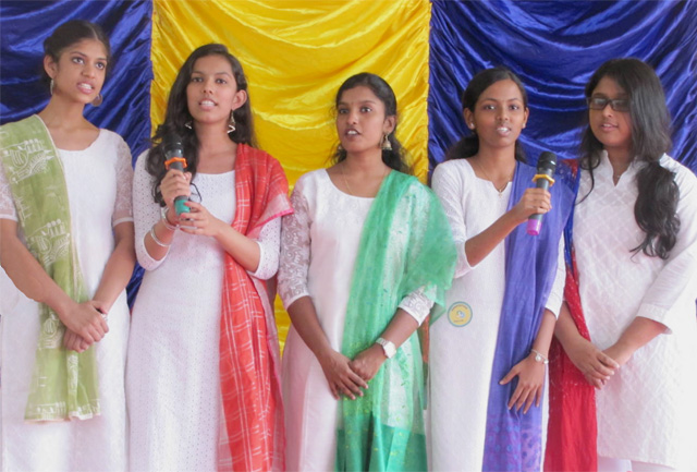 The 10th standard girl offer vocal entertainment.